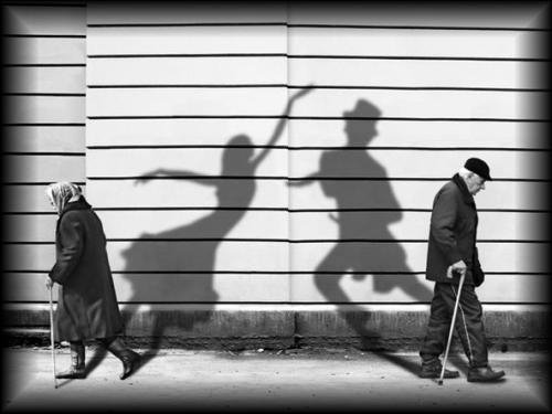Photo of two people with dancing shadows