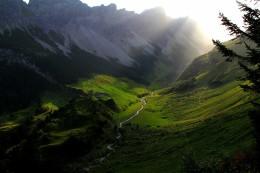 Photo of a sun dappled valley