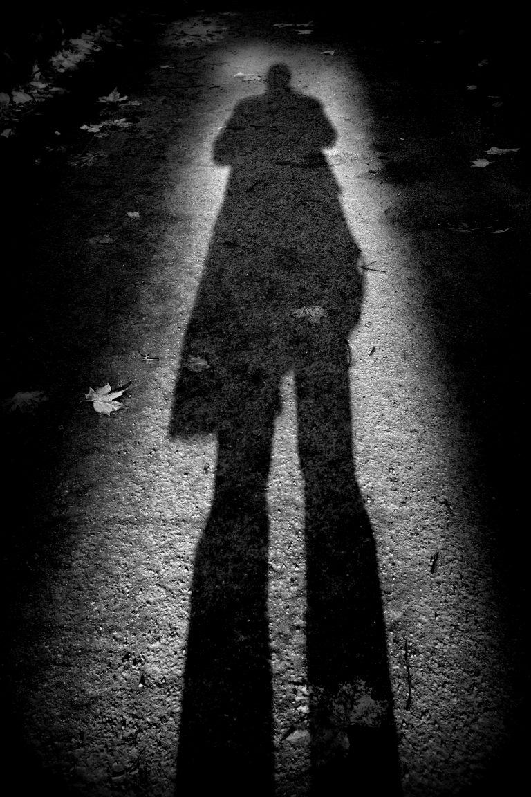black and white photo of the shadow of a man